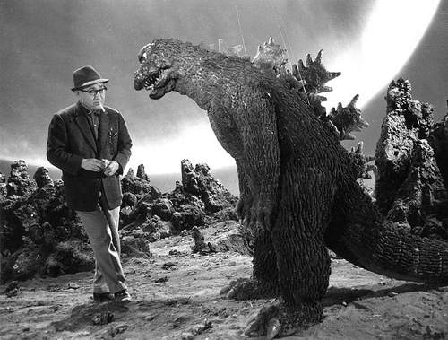 Godzilla bumming a smoke off Tsuburaya between takes.