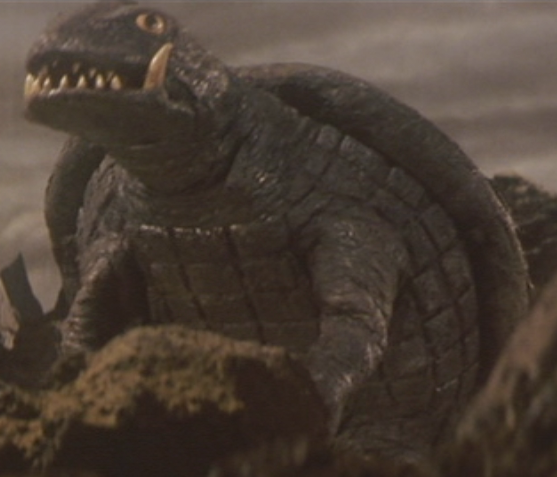 Gamera_-_5_-_vs_Jiger_-_15_-_Gamera_survived_the_flying_Jiger.png