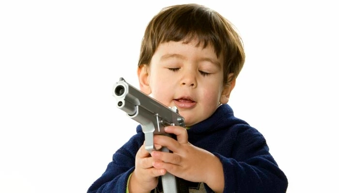 kid-playing-with-gun-1-592a2e05e042aa3e9c1fbf9fb62675f4.jpg